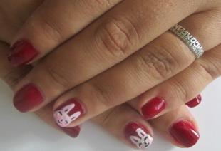 Рисунки на красных ногтях, красный пасхальный маникюр с кроликами