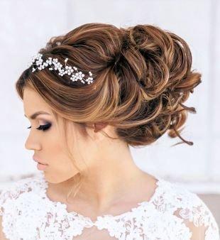 Свадебные прически на длинные волосы, прическа бант аполлона