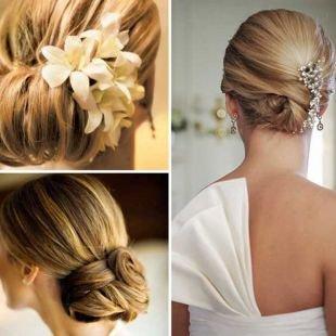 Свадебные прически на средние волосы, изящный низкий пучок с заколкой